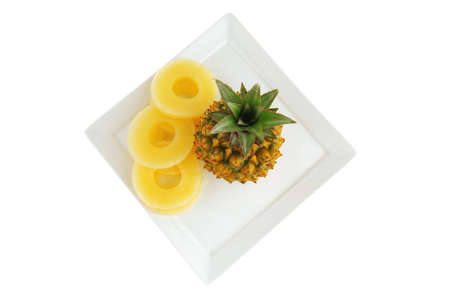 raw pineapple and his slices on white photo