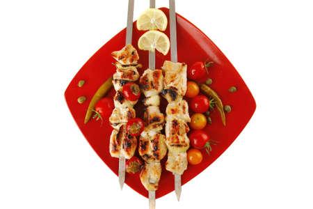 fresh roast shish kebab on red platter photo