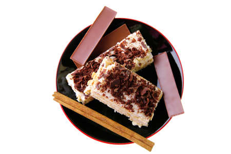 dark chocolate bars and light cake on small saucer photo