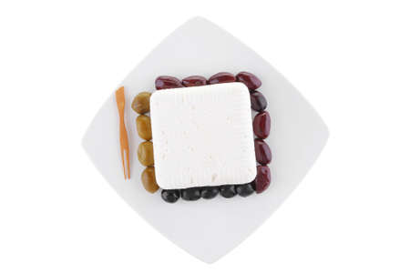 mediterranian: image of feta cheese cube on white plate