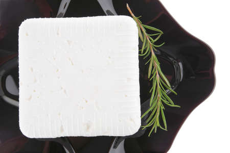 white soft cheese and rosemary on black Stock Photo - 7601192