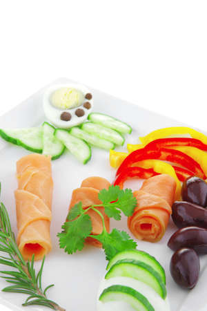 red smoked salmon rolls with olives and peppers photo