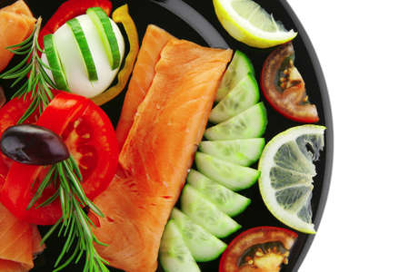 image of served salmon slices and vegetables photo