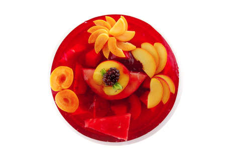 image of cold red jelly cake with nectarine and peach photo