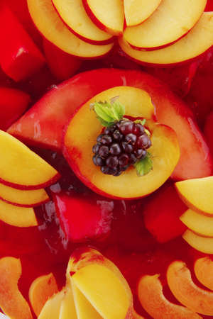 cold red jelly pie with peach and nectarine photo