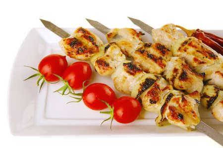 fresh roast shish kebab on white platter photo