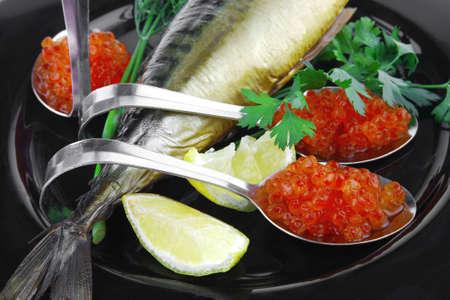 image of smoked mackerel on black plate with caviar photo