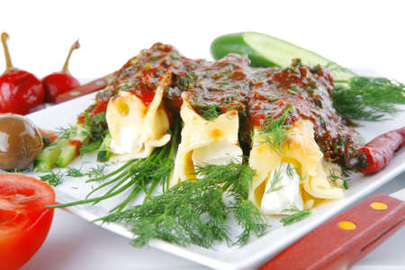 cheese cannelloni served with vegetables on square plate photo