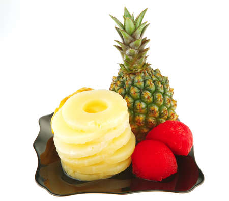 fresh raw exotic fruits on plate over white photo
