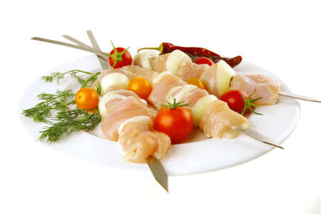 raw fresh chicken shish kebab on white plate photo