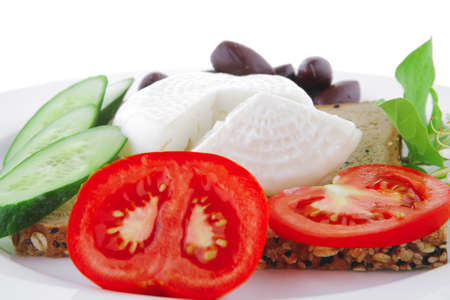 mozzarella on white plate with vegetables and bread photo