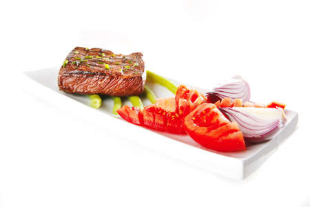 roast beef meat served with tomato on ceramic   photo