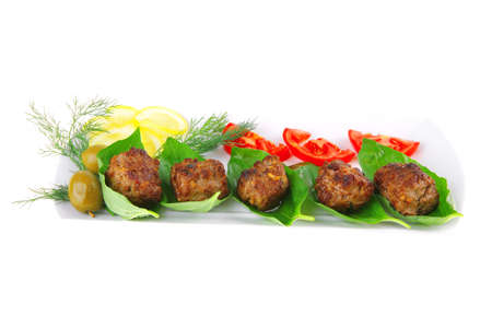 beef meat cutlet with tomatoes on long white plate photo