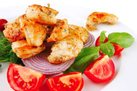 image of grilled chicken meat on white plate Stock Photo