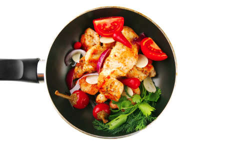 pullet: chicken with tomatoes and hot peppers on pan Stock Photo