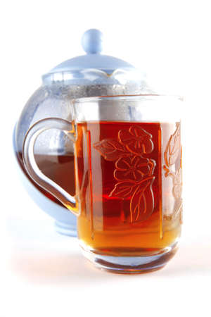 black tea in glass and kettle on white Stock Photo - 7632489
