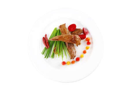 roasted meat chunks served on white plate photo
