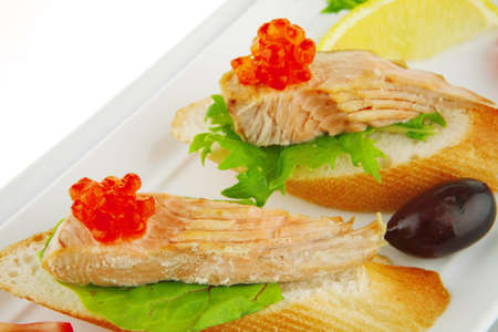 red salmon on baguette served with caviar  photo