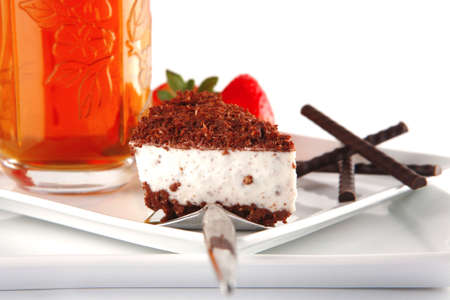 black tea and cake served with strawberry photo
