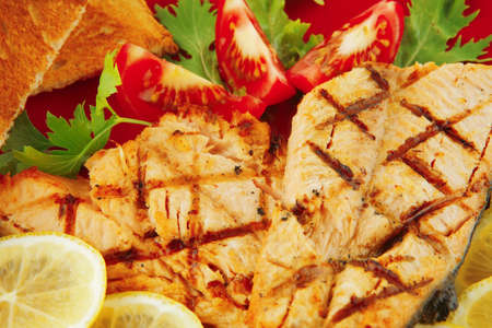 roast red salmon with lemon and tomatoes