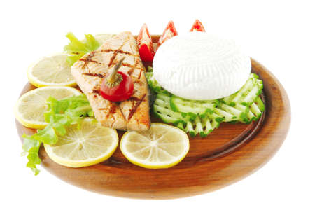 image of salmon with lemon and tomatoes on wood Stock Photo - 7633075
