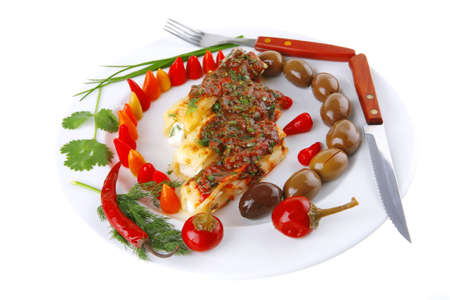 cheese cannelloni served with pepper and tomato on white plate photo
