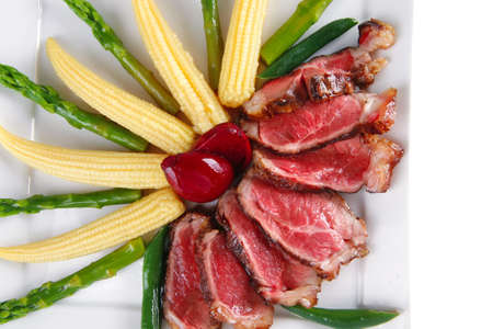 roasted beef served with beans and corns on plate photo