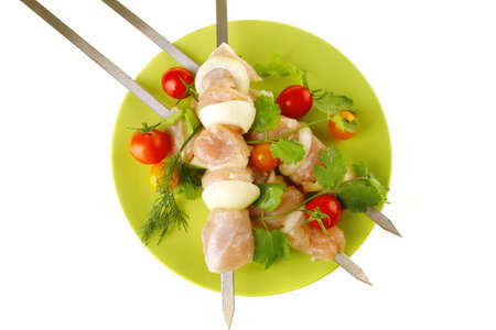served raw chicken kebabs with tomatoes and peppers photo