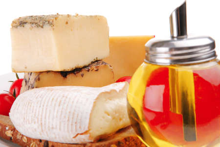 image of old cheeses with oil and bread photo