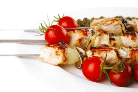 fresh grilled pork shish kebab on white platter Stock Photo - 7643414