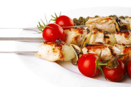 fresh grilled pork shish kebab on white platter Stock Photo - 7643414