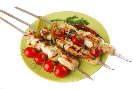 turkish kebab: fresh roast shish kebab on green platter Stock Photo