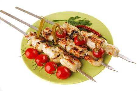 meat skewers: fresh roast shish kebab on green platter Stock Photo