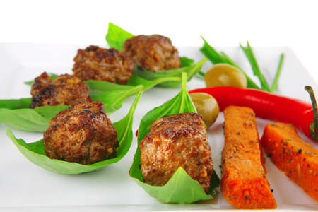 grilled pork: beef small cutlets with basil and hot chilli pepper