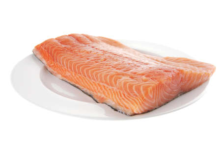 fresh raw red fish fillet on white plate Stock Photo - 7643419