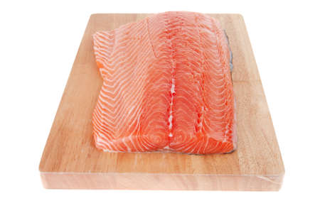 fresh uncooked red fish fillet on wood over white photo