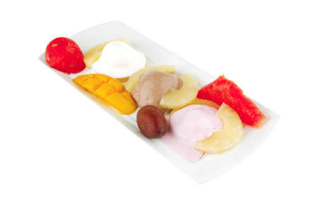brylle: tropical fruits and ice cream on white plate