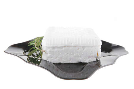 white soft cheese and rosemary on black Stock Photo - 7667449
