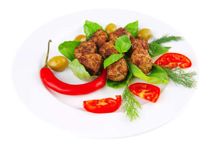 beef meatballs on basil with tomatoes and hot pepper Stock Photo - 7667798