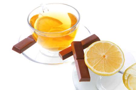 lemon tea and chocolate strips over white photo