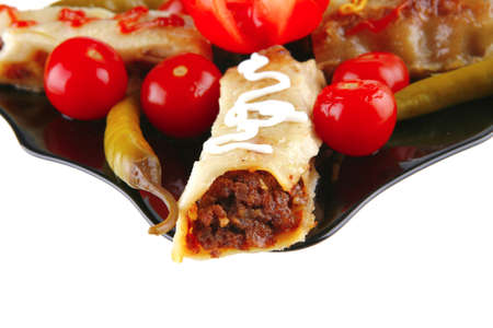 traditional italian cannelloni filled meat with garnish photo