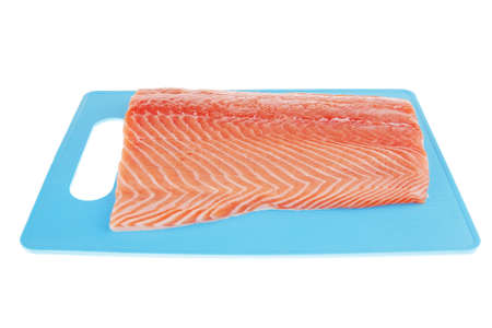 fresh uncooked red fish fillet on blue plate over white Stock Photo - 7713923