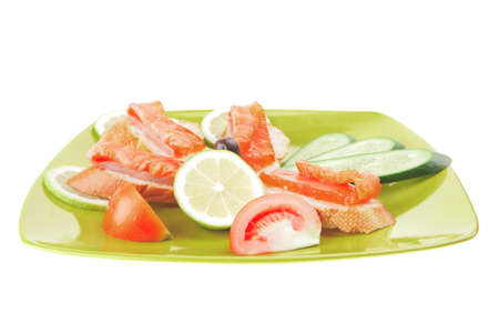 small salmon sandwich on green plate over white Stock Photo - 7713908