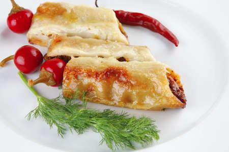 traditional italian cannelloni and small hot peppers photo