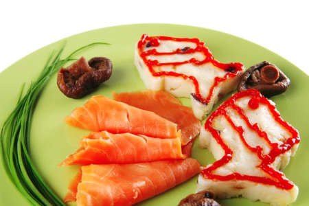red smoked salmon with mash served on green plate photo