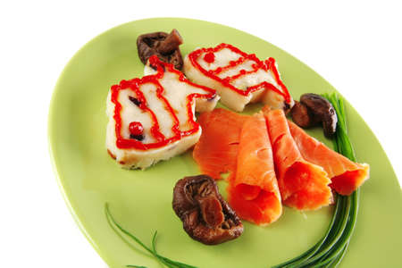 smoked salmon served with mashed potatoes on green photo