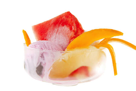 transparent cup with ice cream and tropical fruits photo