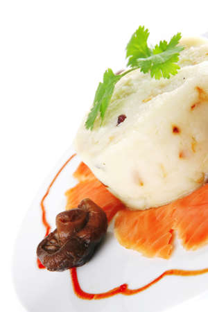 red smoked salmon with mash served on white plate photo