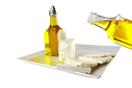 whole light feta cheese in olive oil photo