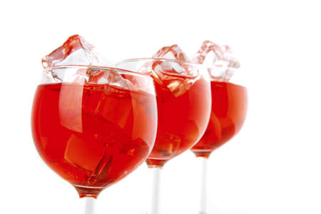 red wine and ice cubes on white photo
